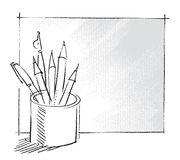 Penna e matite in una latta Immagini Stock