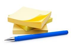 Penna e nota fotografia stock