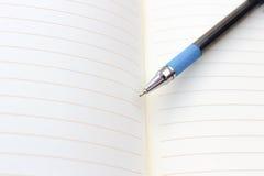 Penna e taccuino Immagine Stock