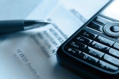 Penna e telefono mobile Immagine Stock