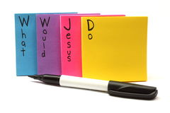 Penna e WWJD che cosa Jesus farebbe le note appiccicose Immagini Stock