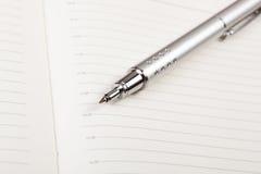Penna ed ordine del giorno fotografia stock