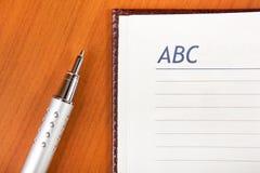 Penna ed ordine del giorno Immagini Stock