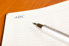 Penna ed ordine del giorno Immagine Stock