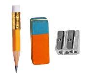 Penna, eraser ed affilatrice fotografia stock