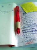 penna för 01 anteckningsbok Arkivbild