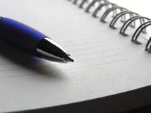 penna för anmärkning för bok 4 Arkivfoton