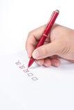 penna för askkontrollhand Arkivbilder