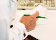 penna för grön man för affär Royaltyfri Fotografi