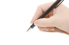 Penna in mano della donna Fotografia Stock Libera da Diritti