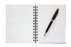 Penna nera su un taccuino con una griglia Fotografia Stock