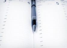 Penna och schema Arkivbild