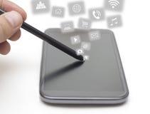 Penna och Smart telefon med Apps Arkivbild