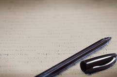 Penna på arket av papper Arkivbild