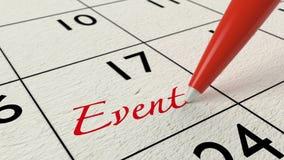 Penna rossa che scrive l'evento di parola in un calendario Immagini Stock