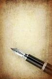 Penna stilografica a su carta Fotografie Stock