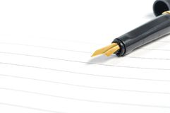 Penna stilografica sul taccuino Fotografia Stock Libera da Diritti