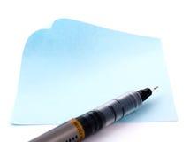 Penna su pezzo di carta blu Immagine Stock Libera da Diritti