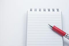 Penna sul blocco note Immagine Stock