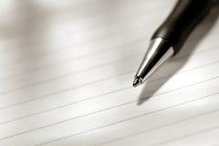 Penna sul foglio di carta Fotografia Stock