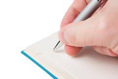 Penna in suoi mano e taccuino Fotografie Stock Libere da Diritti
