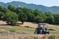 View of tracktor on the field Royalty Free Stock Images