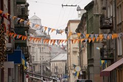 Pennants between buidings Stock Images