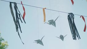 Pennants hanging on line and waving in wind with blue sky behind stock video footage