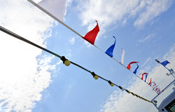 Pennants and lamps at a boat Stock Photography