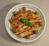 Penne 1. Close-up of penne with tomato-mushroom sauce, olives, parmesan and basil leaf Royalty Free Stock Photo