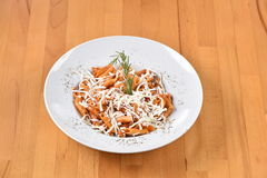 Penne Arrabiata. Served with cheese Royalty Free Stock Photo