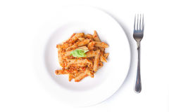 Penne arrabiata on white plate Royalty Free Stock Photo