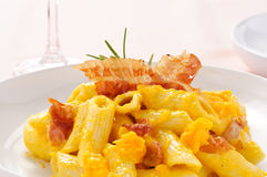 Penne with bacon and pumpkin Stock Photo