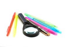 Penne, ballpoint e magnifer Immagini Stock Libere da Diritti