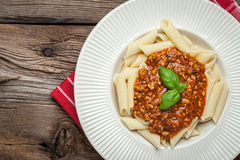 Penne a bolognese on white plate. Stock Image