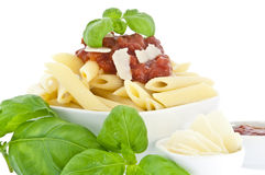 Penne in bowl decorated with fresh basil Royalty Free Stock Photo