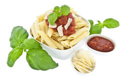 Penne in bowl decorated with fresh basil Stock Photos