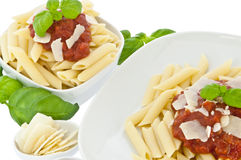 Penne in bowl and on a plate with tomatoe sauce Royalty Free Stock Photography