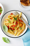 Penne with cheese and tomato Stock Image