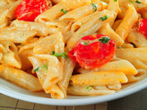Penne with cherry tomatoes Royalty Free Stock Photos