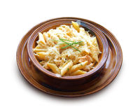 Penne with chicken breast and cheese on a clay bowl Royalty Free Stock Photography
