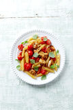 Penne with chicken and cherry tomatoes Stock Image