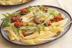 Penne with chorizo Stock Photos