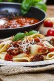 Penne con i pomodori secchi. Cucina italiana fotografia stock libera da diritti