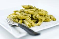 Penne con la salsa di Pesto Immagine Stock