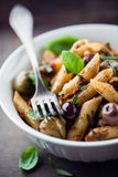 Penne with dried tomato pesto, olives and herbs Royalty Free Stock Photo