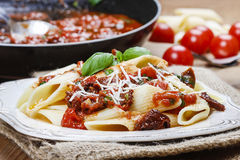 Penne with dried tomatoes. Italian cuisine Royalty Free Stock Photography