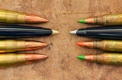 Penne e pallottole Fotografia Stock Libera da Diritti