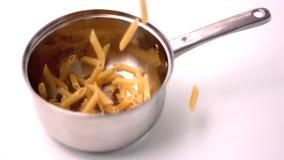 Penne falling in pot. In slow motion stock video