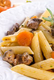 Penne with goulash Stock Images